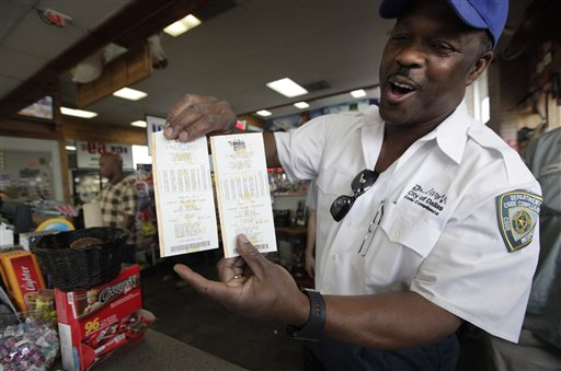 City of Dallas code inspector Frank Forshee shows off his Mega Millions lottery tickets he bought during his lunch break at the Fuel City store Friday, March 30, 2012 in Dallas. (AP Photo/LM Otero)