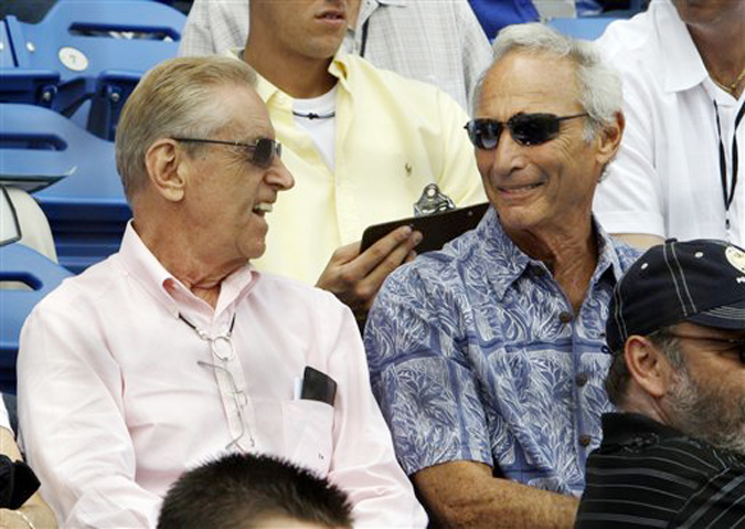 In this March 2009 photo, New York Mets owner Fred Wilpon, left, and his childhood friend, Hall of Fame pitcher Sandy Koufax, sit together during a spring training game in Port St. Lucie, Fla. Koufax, who invested with financier Bernard Madoff at Wilpon's urging, had been expected to testify on behalf of Wilpon before the settlement was announced.