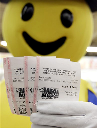 Mega Millions Lottery tickets that were given away to the first 540 people are displayed by the Hoosier Lottery's Mega Millions mascot at a store in Zionsville, Ind., Friday, March 30, 2012. The Mega Millions Lottery jackpot had reached a record $540 million, but quickly jumped to $640 million. (AP Photo/Michael Conroy)