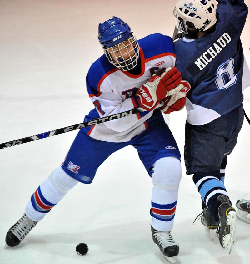 Messalonskee High School's Sam Dexter, 7, makes contact with Presque Isle High School's William Blake, 8, in the first period in the eastern regional play-off game at Sukee Arena in Winslow Saturday.
