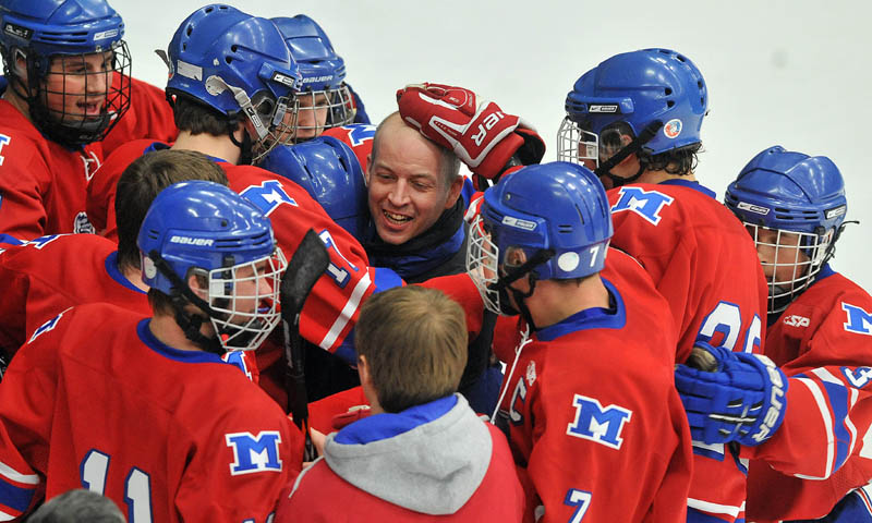 Photo by Michael G. Seamans Messalonskee High School head coach Michael Latendresse celebrates with his team after defeating Brewer High School in the Class B East hockey regional finals at Alfond Arena at the University of Maine in Orono Tuesday night. Messalonskee defeated Brewer 5-2.