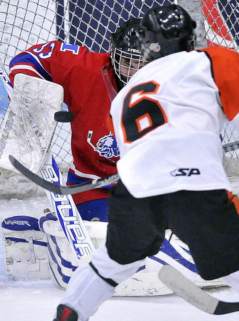 Photo by Michael G. Seamans in the second period of the Class B East hockey regional finals at Alfond Arena at the University of Maine in Orono Tuesday night.