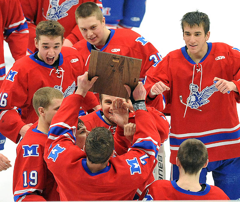 Photo by Michael G. Seamans in the third period of the Class B East hockey regional finals at Alfond Arena at the University of Maine in Orono Tuesday night. Messalonskee defeated Brewer 5-2.
