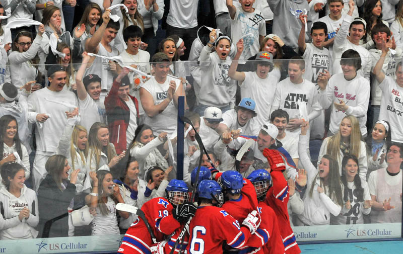 Photo by Michael G. Seamans Messalonskee High School hockey players celebrate a goal in front of the student fans in the second period of the Class B East hockey regional finals at Alfond Arena at the University of Maine in Orono Tuesday night.