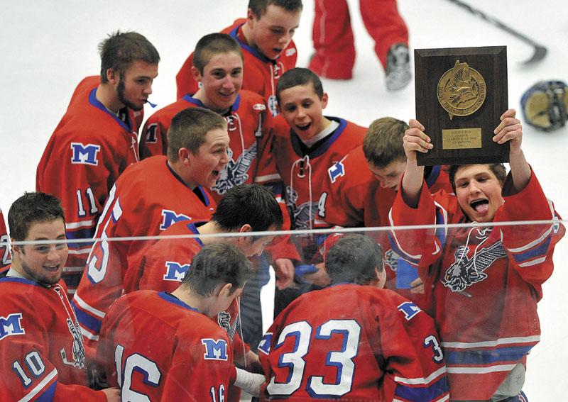 WAY TO GO: Messalonskee players celebrate around head coach Mike Latendresse after they won the Eastern Maine Class B title with a 5-2 win over Brewer on Tuesday night at the Unviersity of Maine in Orono.