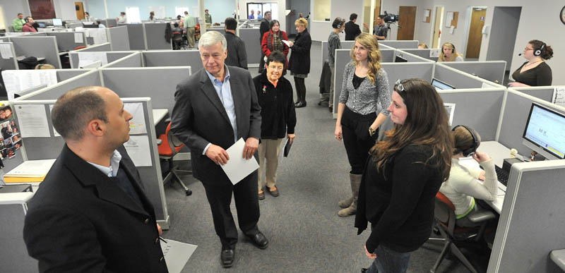 CALL CENTER: U.S. Rep. Mike Michaud, D-2nd District, left center, and Argo Marketing Group CEO Jason Levesque, left, tour the Argo facility in Pittsfield on Friday.