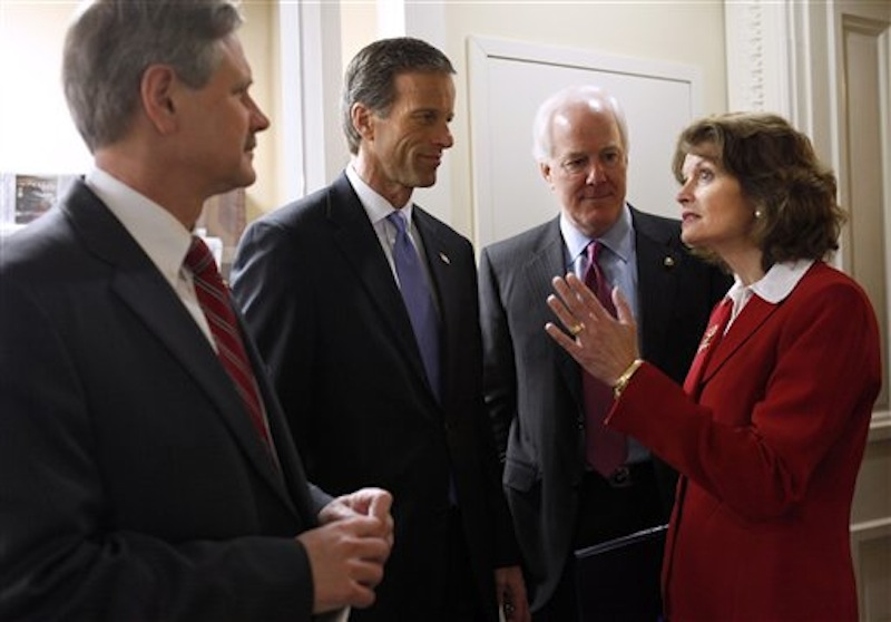 In this Feb. 29, 2012 photo, Republican Sen. Lisa Murkowski, R-Alaska, talks Republican Senators, from left, John Hoeven, R-N.D., John Thune, R-S.D., and Sen. John Cornyn, R-Texas, prior to a news conference on gas prices on Capitol Hill in Washington. Murkowski, 54, a moderate in an era of paralyzing partisanship, may be a natural heir to the centrist role played by retiring Maine Sen. Olympia Snowe at a time when their party is hurting for female leaders. (AP Photo/Jacquelyn Martin)
