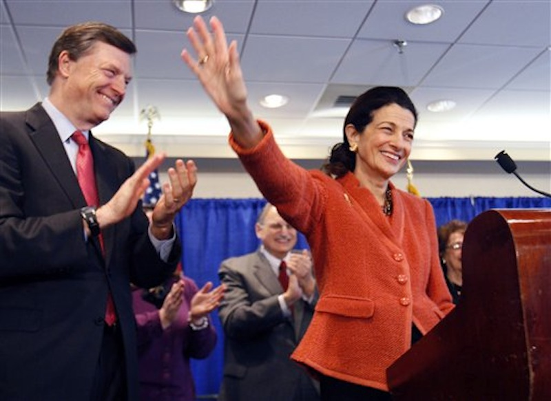 In this March 2, 2012 photo Republican Sen. Olympia Snowe, R-Maine, is applauded by her husband, Jock McKernan, left, and others as she waves goodbye at the end of a news conference in South Portland, Maine, where she announced she would not seek a fourth term. Republican Sen. Lisa Murkowski, R-Alaska, a moderate in an era of paralyzing partisanship, could be a natural heir to the centrist role played by Snowe at a time when their party is hurting for female leaders. (AP Photo/Robert F. Bukaty)