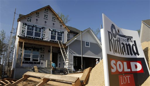 Builders work on a new home in Mechanicsville, Va., today. Sales of U.S. new homes fell in February for the second straight month, a reminder that the depressed housing market remains weak despite some improvement.