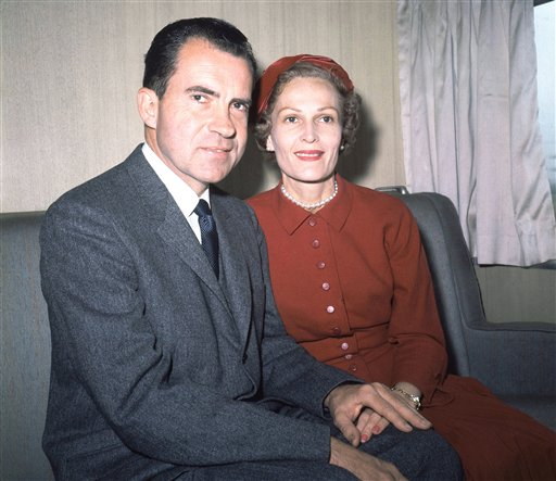 Former President Richard Nixon, left, and his wife Pat pose for photos while campaigning at Rockefeller Center in New York on June 5, 1960.