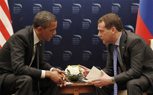U.S. President Barack Obama, left, and Russian President Dmitry Medvedev chat during a bilateral meeting at the Nuclear Security Summit in Seoul, South Korea, today.