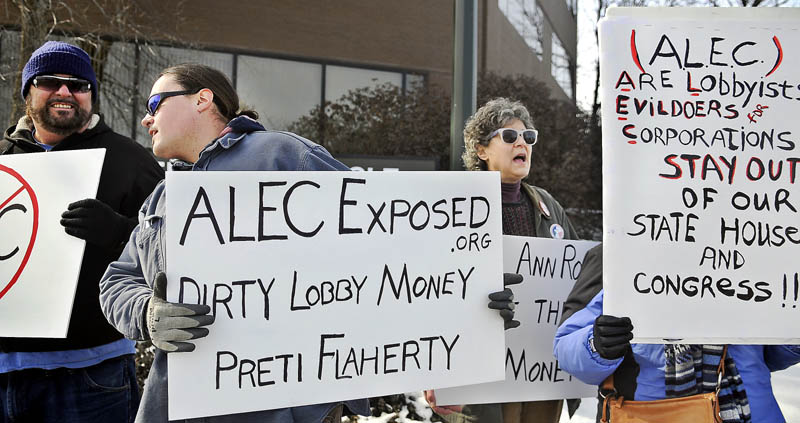 Members of Occupy Augusta picket Wednesday in front of the Augusta offices of the law and lobbying firm Preti Flaherty. Occupy wanted to raise attention about corporate influence on the political process during its noon time demonstration.