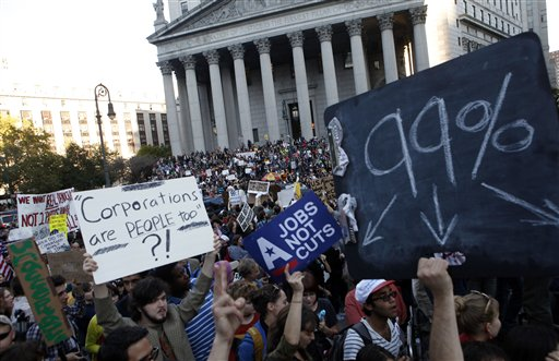 Occupy Wall Street protesters join a labor union rally in Foley Square before marching on Zuccotti Park in New York's Financial District in this Oct. 5, 2011, photo.