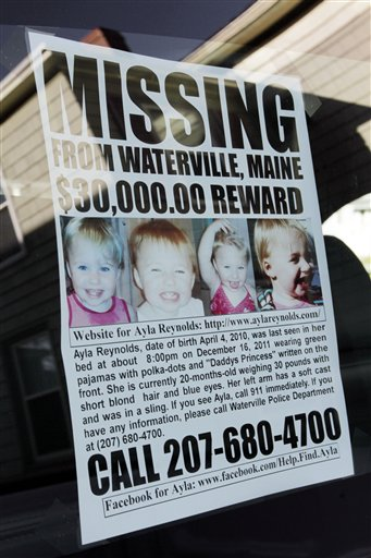 A poster showing missing toddler Ayla Reyolds hangs in the back window of Jeff Hanson's truck at his home in Portland on Tuesday.