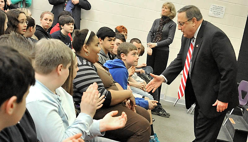 RETURN TO WATERVILLE: Gov. Paul LePage shakes hands with eighth-graders at Waterville Junior High School on Wednesday. Gov. LePage was the keynote speaker for Career Conversations, a five-week program at the junior high that featured talks from career professionals. The former Waterville mayor told students about the rewards and challenges of being governor.