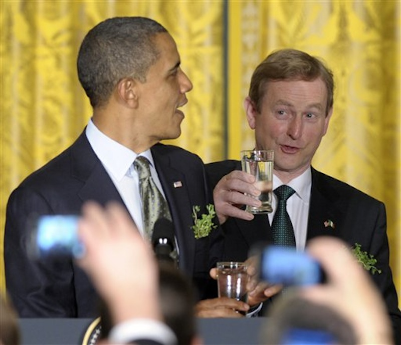 "In this March 20, 2012, file photo President Barack Obama and Irish Prime Minister Enda Kenny prepare for a toast during a St. Patrick's Day reception in the East Room of the White House in Washington. During the reception Enda presented Obama with a certificate of Irish heritage. ""This will have a special place of honor alongside my birth certificate,"" Obama deadpanned, drawing big laughs. (AP Photo/Susan Walsh)"
