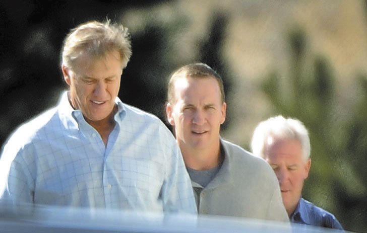 DRAWING INTEREST: Quarterback Peyton Manning, center, takes a tour with Denver Broncos executive vice president of football operations John Elway, left, and Broncos coach John Fox recently in Englewood, Colo.