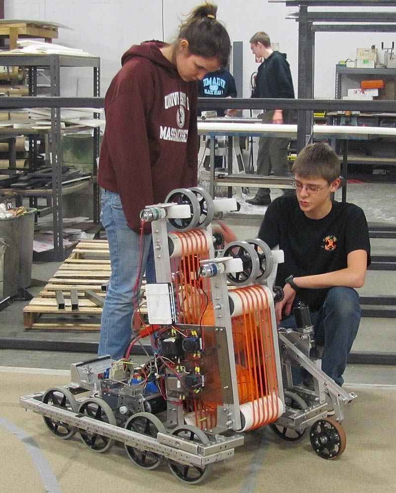 THE MACHINISTS: Infinite Loop Robotics Team members Sabine Fontaine and Brady Snowden handle the team's competition robot.