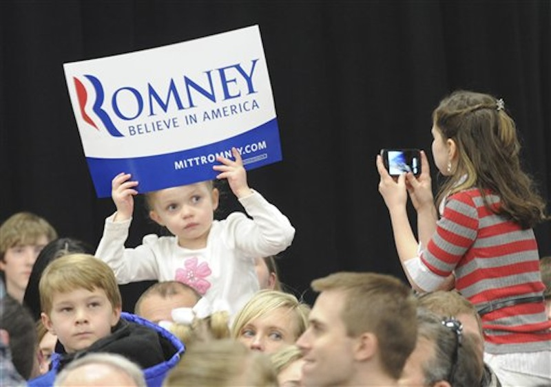 Bella Mow, 4, sits on her father Michael's shoulders and had her picture taken by Savannah Stewart, 9, as they wait for the arrival of Republican presidential candidate Mitt Romney on Thursday, March 1, 2012 in Idaho Falls, Idaho. (AP Photo/The Idaho Post-Register) rb;romney;mitt;gop;election;vote;skyline;campaign;waite;stewart;mow