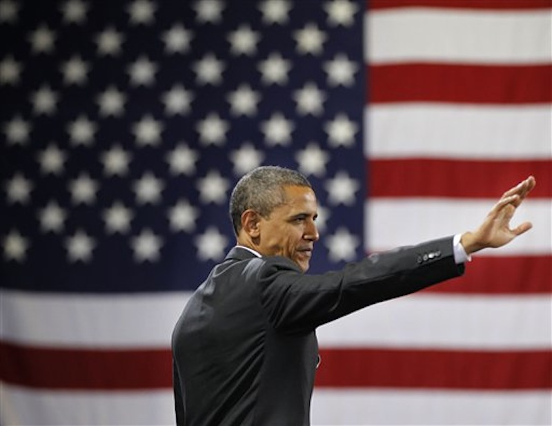 President Barack Obama waves to the crowd after speaking at a fundraiser at Southern Maine Community College, Friday, March, 30, 2012 in Portland, Maine. (AP Photo/Pablo Martinez Monsivais)