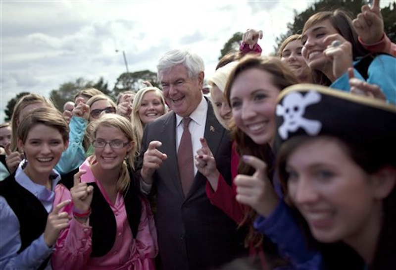 Republican presidential candidate Newt Gingrich poses for photos with the