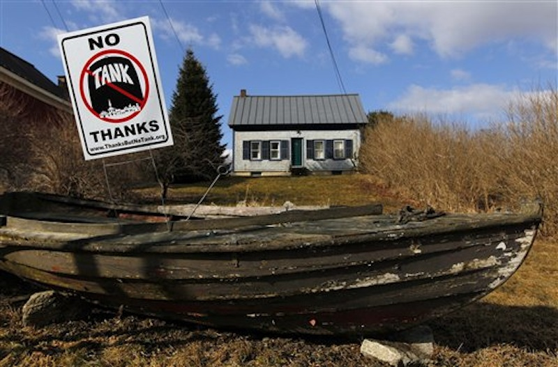 A sign opposing a proposed 23 million-gallon propane tank is seen in a dory in front of a home in Searsport.