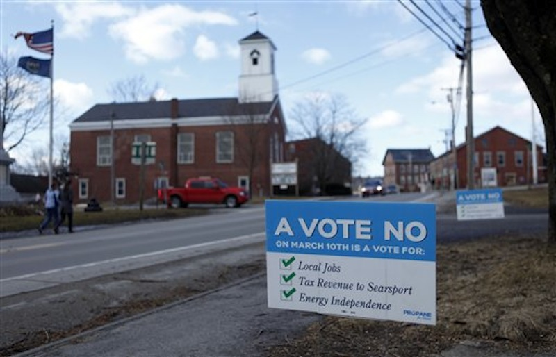 A sign in Searsport on Friday advocates support for a proposed 23 million-gallon propane tank.