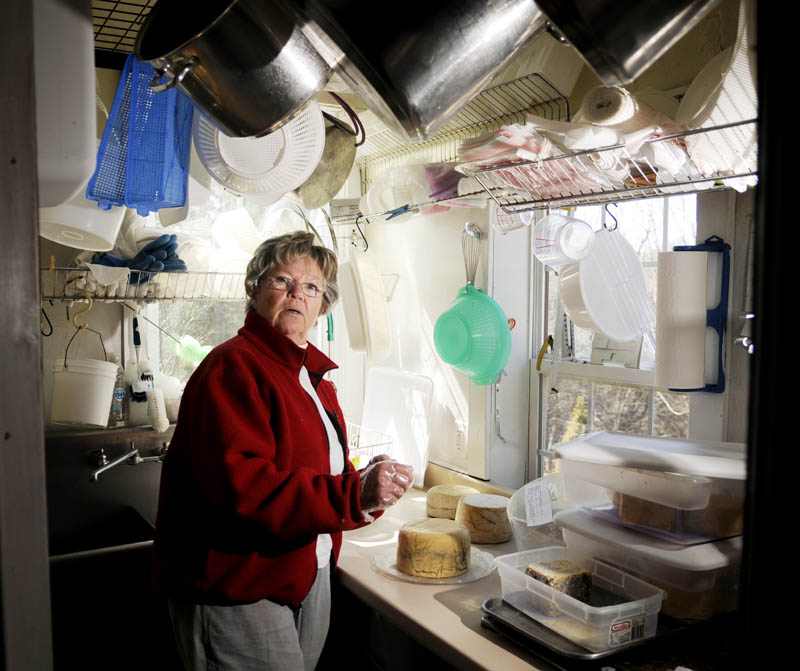 Barbara Skapa creates a variety of cheeses in a closet at Echo Ridge Farm in Mount Vernon on Tuesday. A variety of her cheeses are being served at a fundraiser for President Barack Obama.