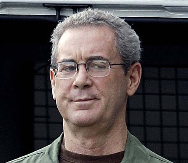 Texas tycoon R. Allen Stanford arrives in custody at the federal courthouse in Houston in this Aug. 24, 2010, photo.