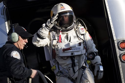In this photo provided by Red Bull Stratos, Felix Baumgartner salutes as he prepares to board the capsule carried by a balloon during the first manned test flight for Red Bull Stratos in Roswell, N.M., on Thursday. Baumgartner is more than halfway toward his goal of setting a world record for the highest jump.