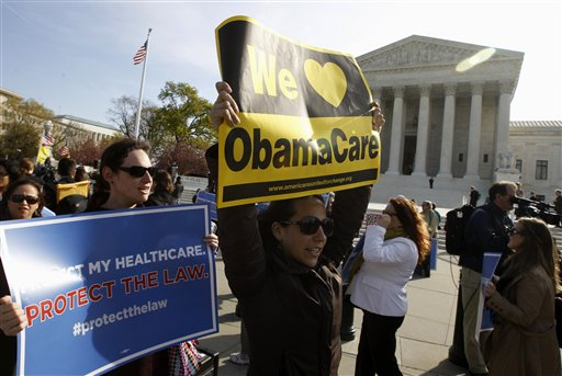 Supporters of health care reform rally in front of the Supreme Court in Washington today on the final day of arguments regarding the health care law signed by President Barack Obama.