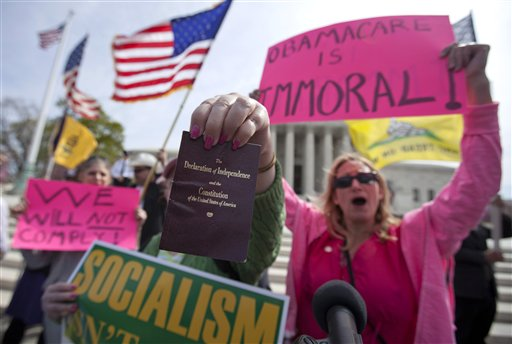 Protesters chant in front of the Supreme Court in Washington on Wednesday.