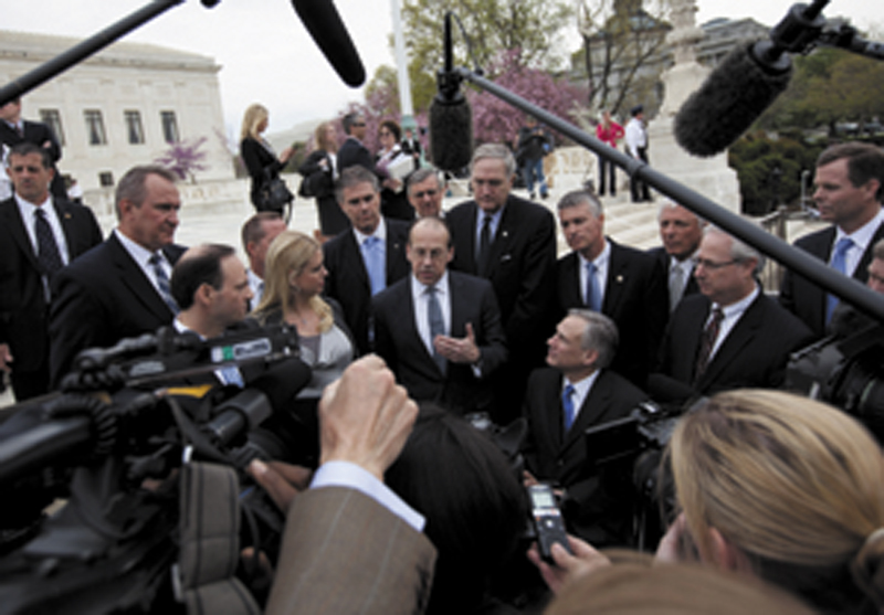 BIG CASE: Paul Clement, a lawyer for 26 states seeking to have the Patient Protection and Affordable Care Act tossed out, speaks to reporters Wednesday in front of the Supreme Court in Washington, at the end of arguments regarding the law.
