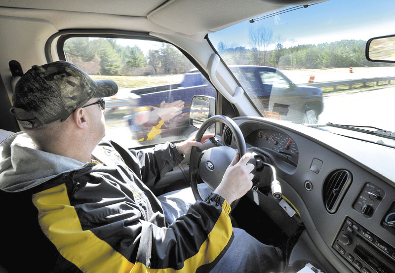 Maine State Police trooper Steven Stubbs spots this driver using his cell phone and speeding and issued him a ticket as Stubbs and fellow trooper Mike Cook patrol the Maine Turnpike in a unmarked van looking for drivers who are texting.