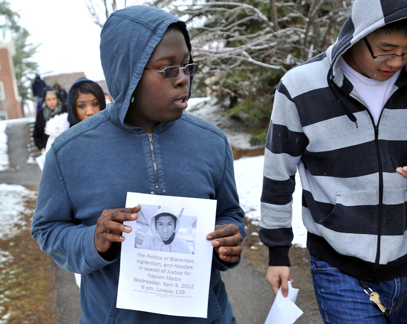 Photo by Michael G. Seamans Colby College sophomore, Omari Matthew, walks with other classmates near the Miller Library during a march to raise awareness of Florida teen, Trayvon Martin, who was fatally shot in February at Colby College Thursday afternoon.
