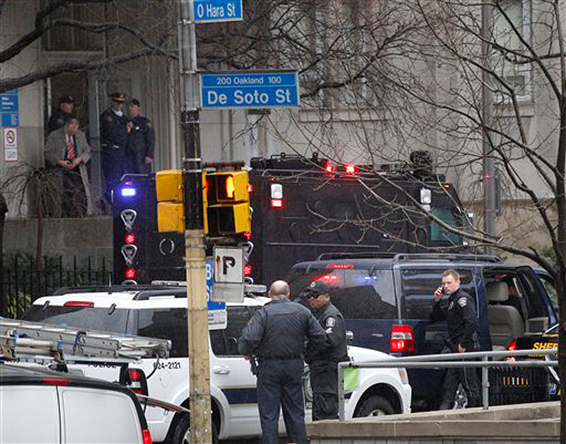 Police gather on DeSoto street near the front entrance to the Western Psychiatric Institute and Clinic on the University of Pittsburgh campus on Thursday, March 8, 2012 in Pittsburgh. (AP Photo/Keith Srakocic)