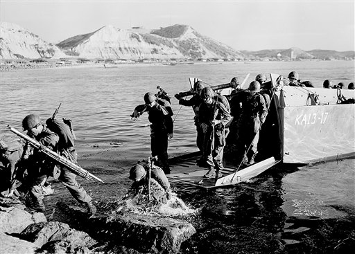 In this July 19, 1950, photo, troops of the First U.S. Cavalry Division land ashore at Pohang on the east coast of Korea during the Korean War.