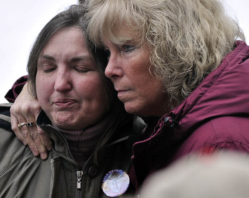 COMFORT: Phoebe DiPietro, grandmother of Ayla Reynolds, is comforted by her friend Connie McCord, of Waterville, at a vigil for the missing toddler at Castonguay Square in downtown Waterville on Saturday.
