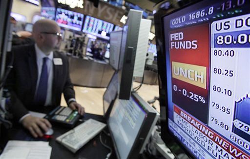 A display screen at a post on the trading floor of the New York Stock Exchange shows the rate decision by the Federal Reserve today.