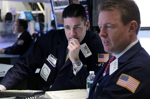 Traders work on the floor at the New York Stock Exchange in New York today as tocks in the were down more than 1 percent at the opening bell, following similar declines in Europe.