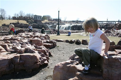 5-year-old Reagan Lovrien plays at Falls Park on Tuesday in Sioux Falls, S.D. Lovrien was at the park with her sister, 3-year-old Kinsey, and her grandmother, Sharon Lovrien of Sioux Falls.