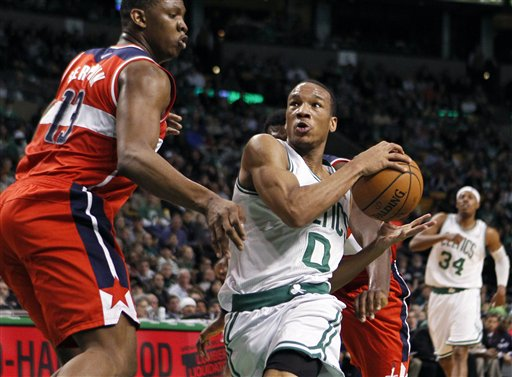 Boston Celtics' Avery Bradley (0) drives past Washington Wizards' Kevin Seraphin (13) in the second quarter of an NBA basketball game in Boston, Sunday, March 25, 2012. The Celtics won 88-76. (AP Photo/Michael Dwyer)