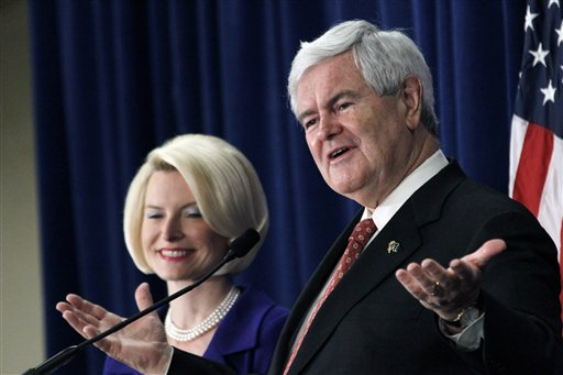 Republican presidential candidate Newt Gingrich, accompanied by his wife Callista, speaks at a rally in Jackson, Miss. on Thursday, March 8, 2012. (AP Photo/Rogelio V. Solis)