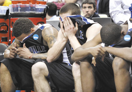 OH SO CLOSE: UNC-Asheville players, from left, J.P. Primm, Matt Dickey and Quinard Jackson cover their faces late during a 72-65 loss against Syracuse in the second round of the NCAA tournament East Regional on Thursday in Pittsburgh. The Syracuse win made it 109-0 for No. 1 seeds against No. 16s since the NCAA went to a field of 64 in 1985.