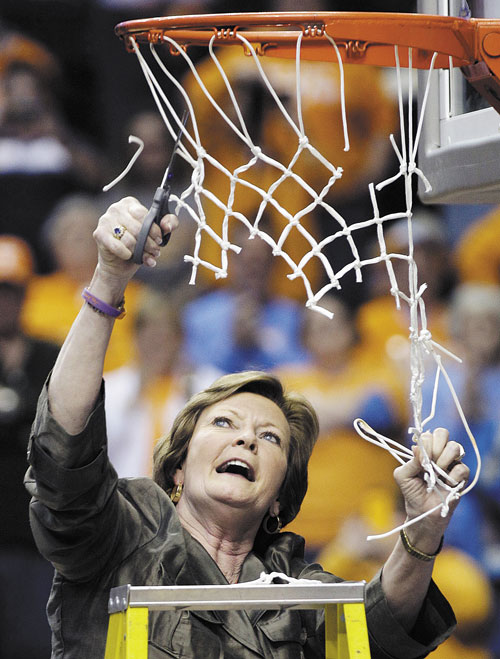 TIME TO CELEBRATE: Tennessee head coach Pat Summitt cuts down the net after the Lady Vols defeated LSU 70-58 to win the Southeastern Conference title last weekend in Nashville, Tenn.