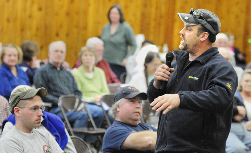 Road commissioner Kevin Hawes answers a question during the Belgrade town meeting on Saturday at the Center for All Seasons.