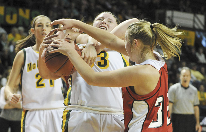 John Ewing/Staff Photographer... Saturday, March 3, 2012...McAuley vs. Cony girls class A state championship game. McAuley's Victoria Lux battles with Cony's #32, Amelia Diplock, during rebounding action.