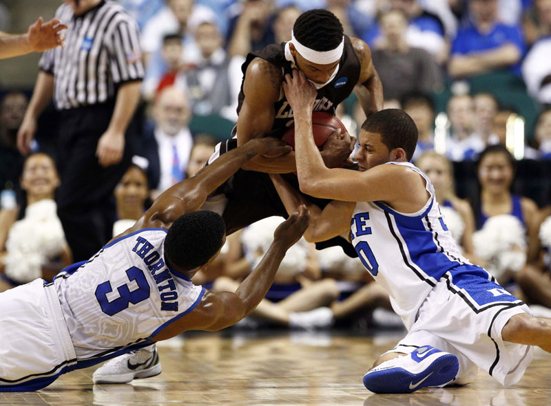 HUSTLE PLAY: Duke's Tyler Thornton, left, and Seth Curry, right, struggle to pry the ball from Lehigh's Mackey McKnight during the first half of their NCAA tournament second-round college game Friday night in Greensboro, N.C. Lehigh pulled the upset, winning 75-70. NCAA