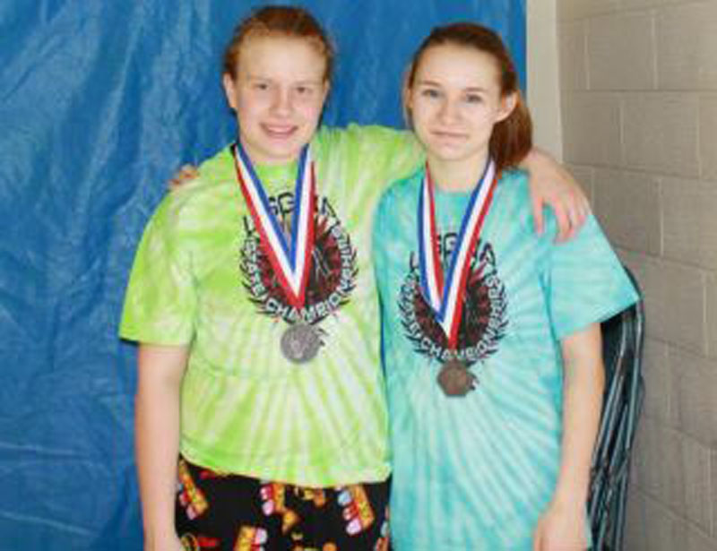BUILDING ON SUCCESS: Monmouth High School's Tammy Cushman, left, and Monmouth eighth-grader Emily Levasseur both placed second in the girls New England Open in Nashua, N.H, and will now compete in the 15th annual National Girls Wrestling championships March 31 and April 1 at Eastern Michigan University in Ypsilanti, Mich.