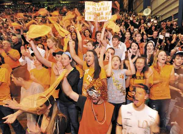 ORANGE CRUSH: Gardiner Area High School fans cheer on the Tigers during the Class B state championship game against Yarmouth on Friday night at the Bangor Auditorium. Gardiner lost 65-53.